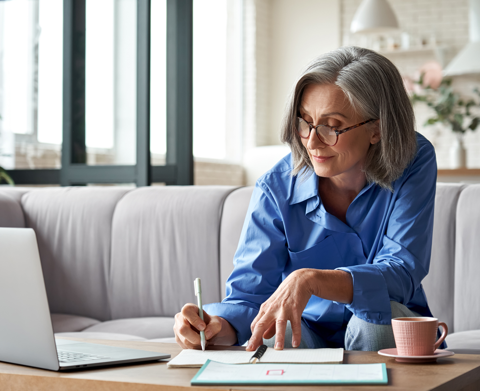 middle-aged woman doing paperwork